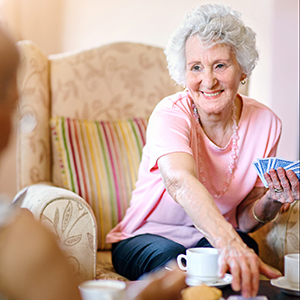 playing cards with senior companion
