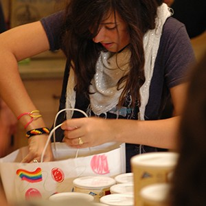 photo of young volunteer filling decorated holiday food bag