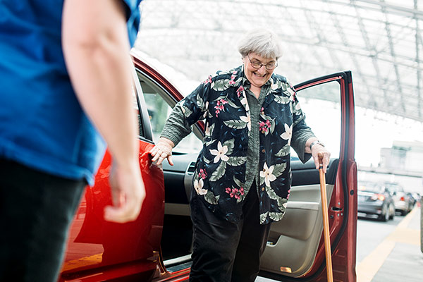 senior getting out of Lyft