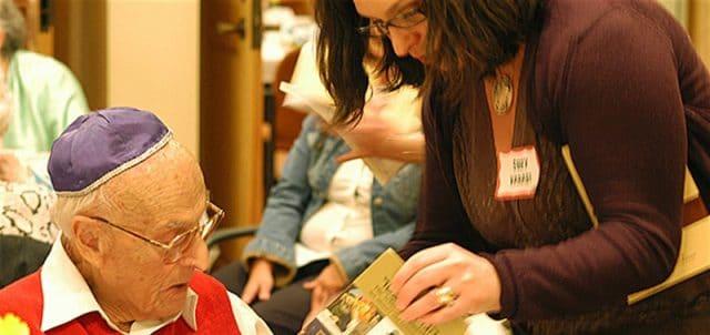 Holocaust survivor with volunteer