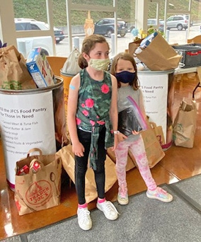 Alanna Klein's daughters, Marlo Robin, age 6, and Sadie Robin, age 9, are among the many Brandeis students donating food to the JFCS High Holiday Food Drive.